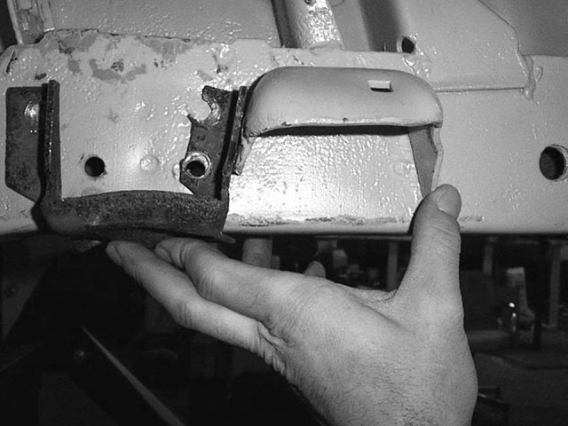 Using a drill with a 1/2-inch bit, remove and discard the lower bumpstop bracket. On '67-'72 models, this is all that's necessary. On '73-'76 models, the upper bumpstop bracket must also be removed.
