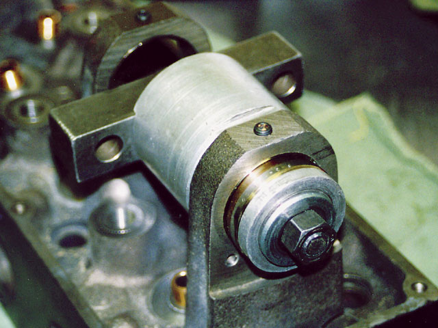 This tool was used to press in cam bearings. There's a 1/16-inch pipe plug in the top oil hole.