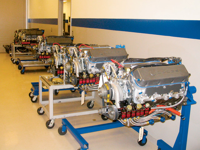 A row of Dodge engines, tested and ready to go, await shipping at the Penske Jasper Engines Complex in Concord, North Carolina. In all, Penske Jasper builds more than 400 new engines annually.