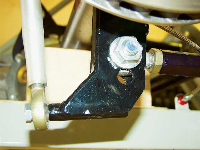 There are usually several holes in the brackets for the upper and lower control arms so that the links can be mounted at different heights. The farther apart the upper and lower links are, the less mechanical leverage there is, and therefore the less antisquat effect. When moving the links, make sure you do not change the angles, and always move the front mounts in the same direction and distance.