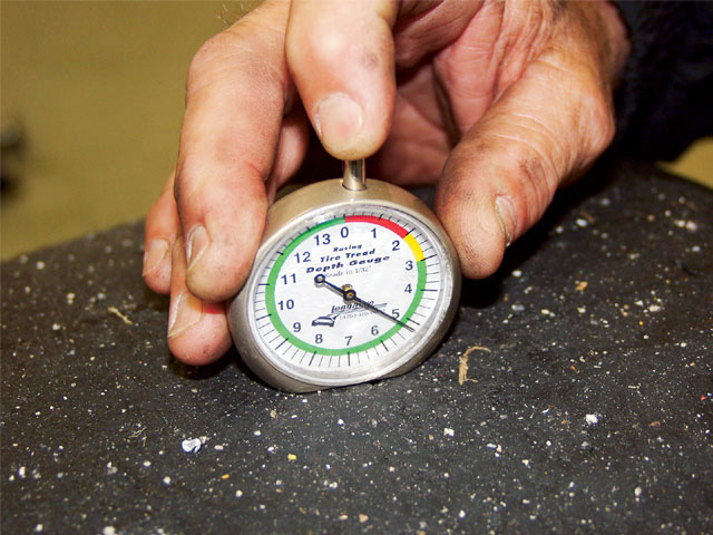 Used properly, a simple tread depth gauge, such as this Longacre unit, can tell exactly how each part of the tire is working. Many teams cut wear grooves, in addition to those that might already exist, to determine if tire pressures and cambers are correct.