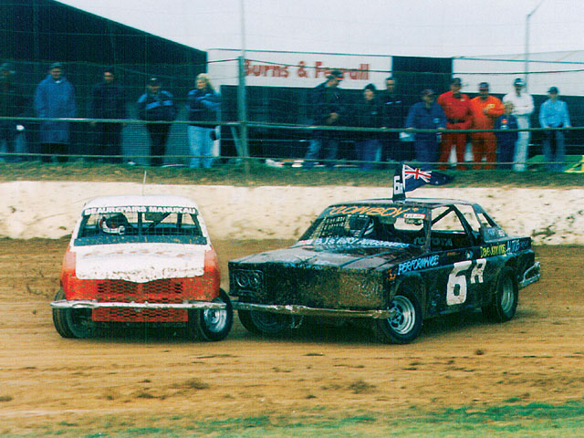 Streetstock racing can be close quarters action as contact is made between Baz Parker (6A) and Lionel Mason (19A) during a Waikaraka Park meeting.