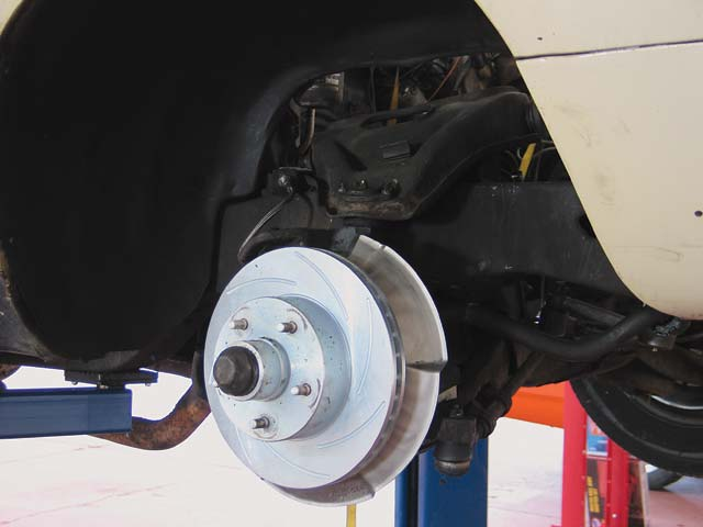 1.  After you've secured the car and removed the wheel and brake caliper, this is what you'll see.