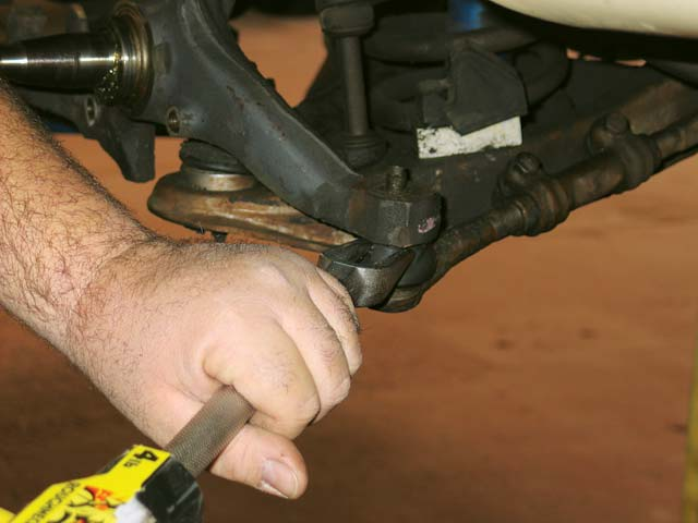 4.  Loosen and remove the tie-rod end.