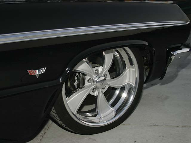 This Impy rolls on 20-inch Intro Twisted Vista wheels clad in Falken rubber; stopping duties are handled by Wilwood.