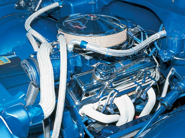 The PPG Ultra Marine and chrome displayed under the hood really sucks you in. Check out the braided aluminum lines complementing the blue. Oh yes, and the 350ci V-8 looks good too.