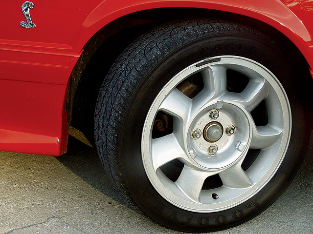 There are always a number of clues to help authenticate a low-mileage car. Pulling the cover from the center of the wheel showed there was virtually no dirt or grime. Wheel weights mounted on the outside of the rim are consistent with how wheels were balanced years ago. Additional research later proved that the Goodyear Gatorbacks were what originally came on the car.