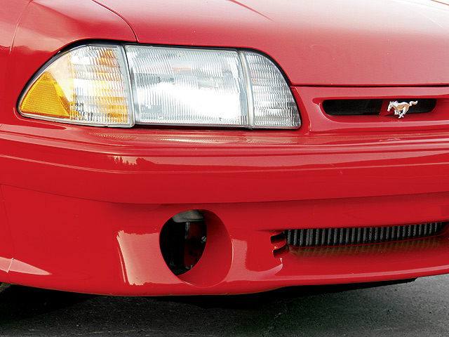 Fox-body Mustangs were known for having headlights that yellowed, but a close examination of the headlight covers showed these were the original Ford units.  The owner had removed the original fog lamps and kept them. The intercooler can be seen through the lower grille opening.
