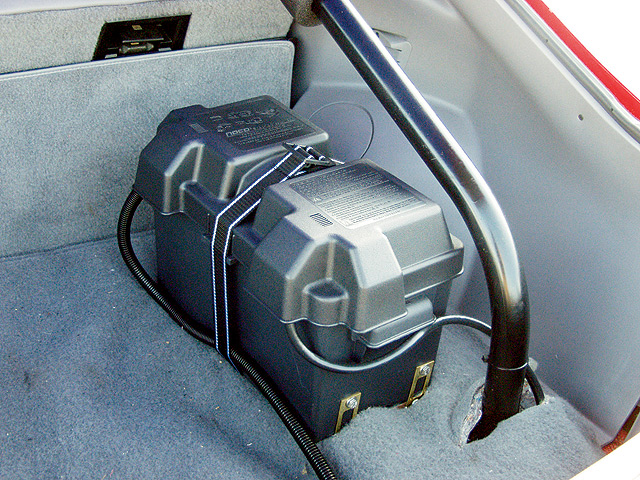 Our project car also came with a 4-point roll bar and a trunk-mounted battery. It turned out that this was not an NHRA-approved installation, so we added an Optima dry cell and a battery disconnect switch on our list of things to look for on eBay Motors.