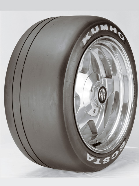 Kumho is serving notice to its race tire competitors with the new Ecsta V710. It's a no-holds-barred slick, with a pair of 4/32-inch grooves for DOT compliance. This tire is going to give the Goodyear GS-CS and the Hoosier R3S04 fits in SCCA classes across the country--and at a scandalously low price.