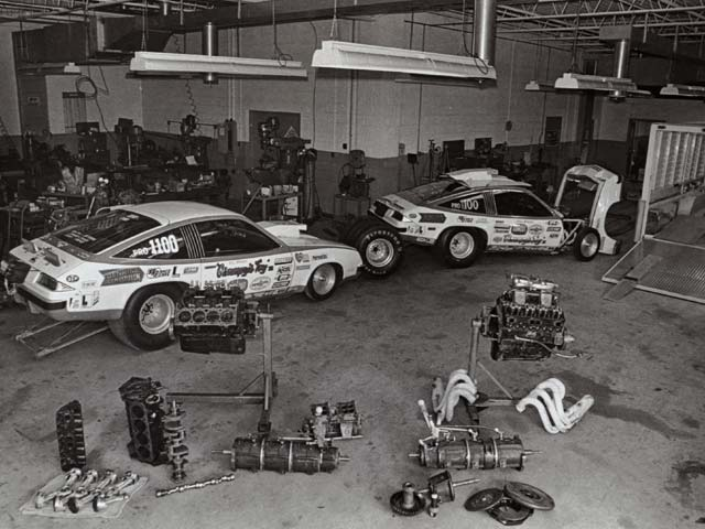 The Lenco transmissions are the cylindrical items in the foreground of Bill Jenkins' shop in 1975.