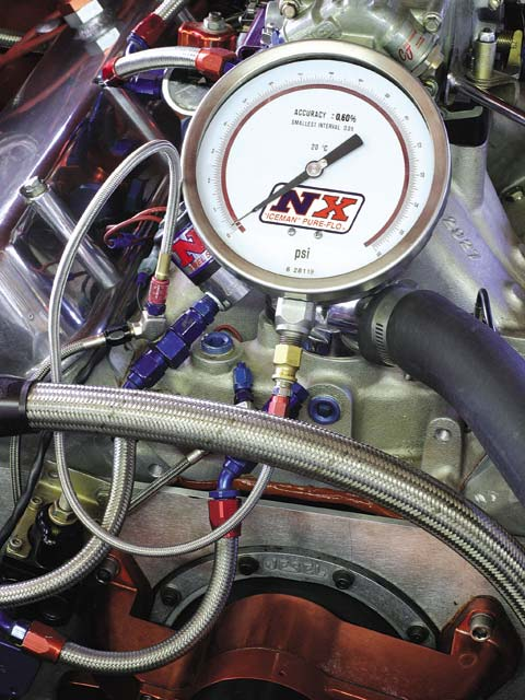 An advantage of a separate nitrous fuel supply is that it can be accurately dialed in by temporarily plumbing the fuel-solenoid outlet side back to the fuel reservoir or into a bucket (an extra capped-off line is seen at the arrow). The regulator can then be accurately adjusted without creep. Nitrous Express offers the huge and highly sensitive gauge.