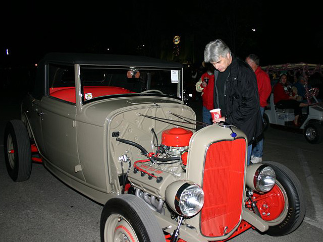 Celebrity judge, author and auto stylist Thom Taylor examines his favorite rod at the Twilight Cruise.