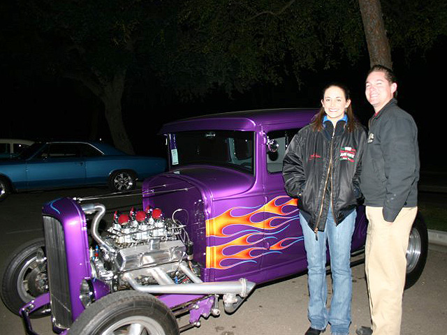 SEMA intern Megan McKernan (L) picked a flamed 1930 Ford Model A owned by Gary Booke.  Colby Martin of SEMA looks on.