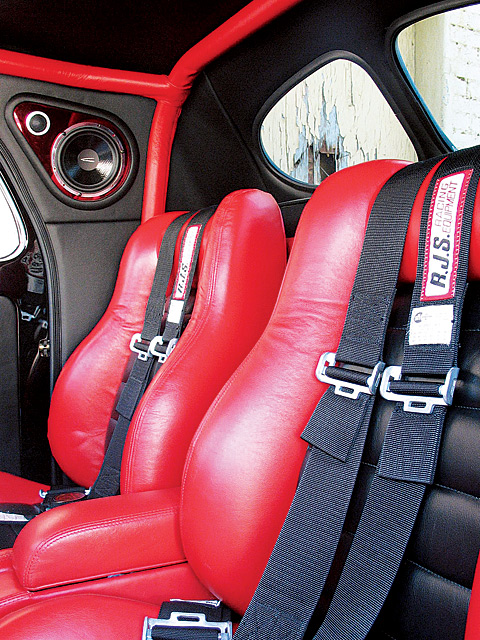 Orange Auto Upholstery did a bang up job of blending style, function, and feng shui when they blended a modern sound system, the safety of a padded leather wrapped rollcage, and the style of Cerullo bucket seats.