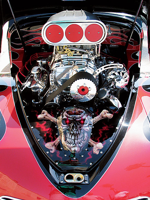 It just doesn't get better than a blown, polished, deburred, and finely tuned 850-plus hp Chrysler 392ci Hemi, unless of course you factor in that this motor was built and tuned by none other than Art and Mike Chrisman. This Hemi features a Mooneyham 671 blower topped with a pair of Holley 700-cfm blower carbs and MSD electronics. Check out the custom radiator cover painted by Danny Scholz of DVS Designs in Fountain Valley, CA.