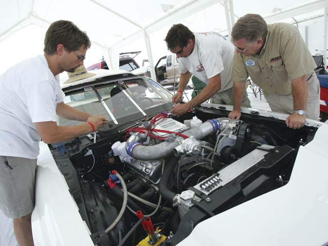 This is (left to right) MSD's Todd Ryden, freelancer Steve Dulcich, and Jesel's Wayne Jesel puttin' the rub to the 408 between passes. We pulled three jets out of it for Bonneville's near-7,000-foot density altitude then ran the valves. With the shaft rockers, the lash never changed from dyno to racetrack.