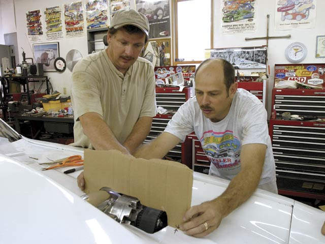 Bruce  Hall (left) and Steve Mohl slashed the hood. Mohl is a savant for quoting articles from HRM and Car Craft.