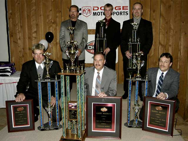 Jennerstown's 2004 champions: (Back row, left to right) Duane Noel(Chargers), Patrick Parlock (Hobby Stocks), and Dink Collarusso (StreetStocks). (Front row, left to right) - Kyle Martel (Legacy Series),Gary Wiltrout (Super Late Models), and Rick Boyer (Late Models).