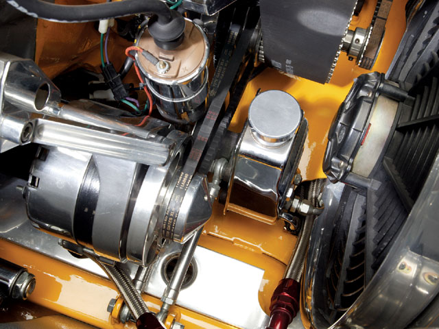 The rear-steer rack-and-pinion steering system is boosted by a reversed pump mounted in front of the engine.