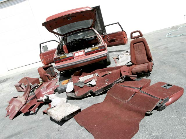 Gutting an interior is easy when you have no intention of putting any of the parts back in. This mess went straight into the dumpster.