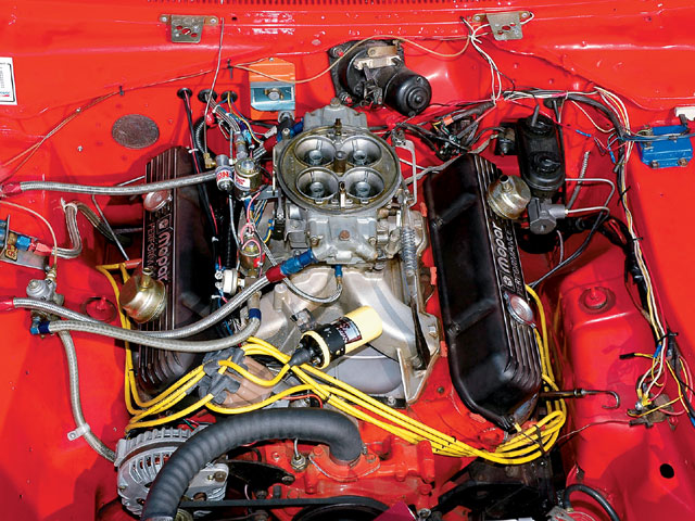 The truth that Todd's willing to reveal to the world is that there's really a 451ci 440 motor under the hood that also has help from a big cam and a Dominator carburetor, but he's also packin' an NOS Big Shot nitrous system. Yeehaw!