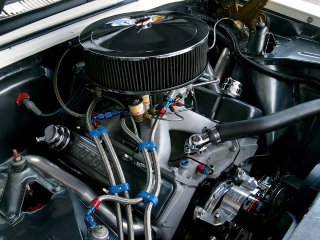 Steve's Nova runs a 406-inch Mouse using a Dart block, 18-degree heads, and an Eagle rotating assembly. The combination is good for 650 hp and 540 lb-ft of torque on motor at the crank. On the 250-horse shot of nitrous, 9.60s at 143 are possible.