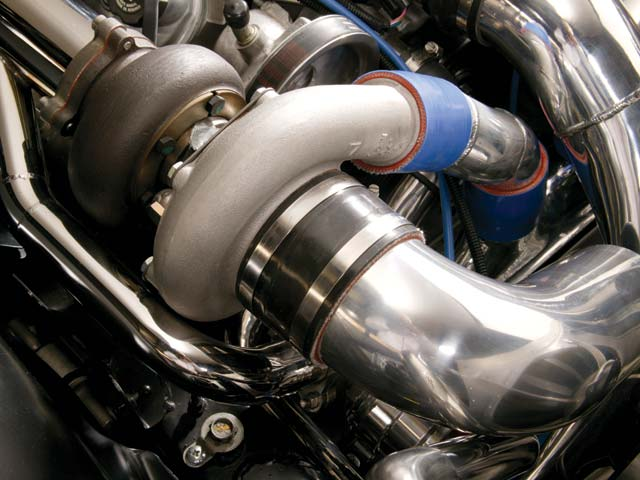 Leno's Big Dog Garage fabricated the amazing plumbing for the turbos, including the air-to-water intercooler.