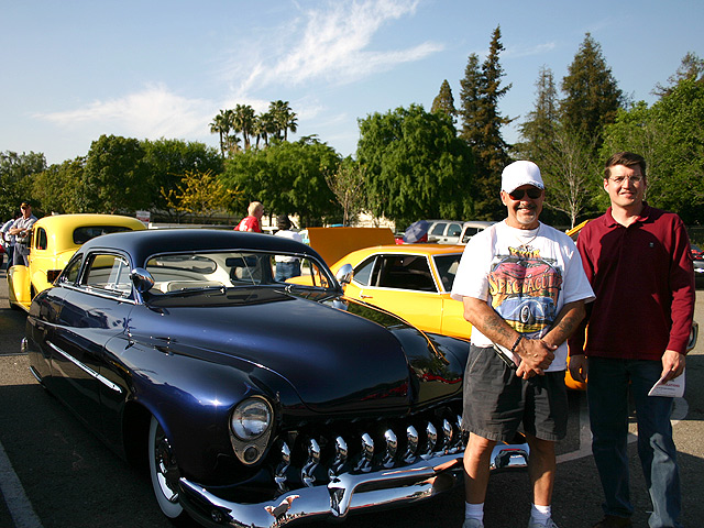 (l-r)Sam Falco receives congratulations on his Mercury from Kevin Lee of Rod & Custom.