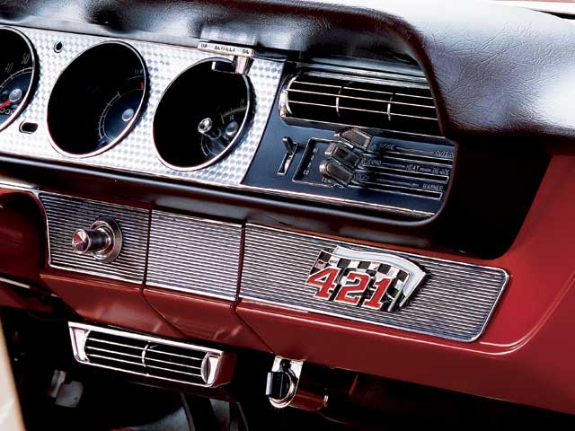A radio block-off plate is cool, and the 421 emblem is cooler. Thepresence of the hidden radio explains the power antenna on a GTO with aradio-delete plate. Bruce and Jim couldn't keep everything a secret.