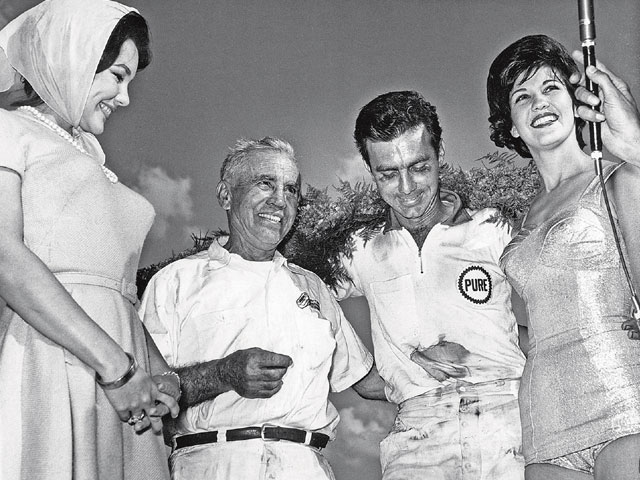 Shorty Johns celebrates after a Darlington race with his son, Bobby, and two unnamed females. Bobby credits his dad for getting him started in racing Pontiacs.
