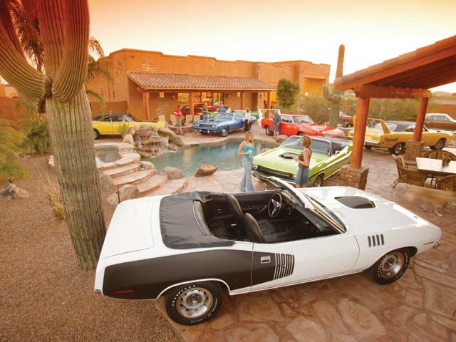 Every car except the Charger Daytona in this photo has a Hemi under its hood. Wiemann recently sold the blue '71 'Cuda for $3 million. The heavily optioned, four-speed, green Challenger convertible is one of nine. This happens every day at his house.