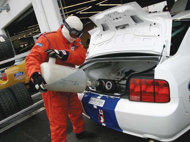 The Mustang's stock saddlebag gas tank mounted ahead of the rear axle is replaced with a trunk-mounted 20-gallon fuel cell with a twin-nozzle dry break for quick refueling stops.