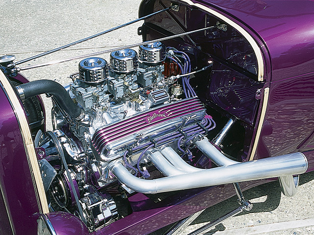 Today's powerplant is a 350 Chevy decked with Mondello heads, a Crane cam, and an MSD Blaster ignition. Note the Rochester carbs that now rest where once a trio of 97s rested. Ron Attebury built the chromed cutout headers.
