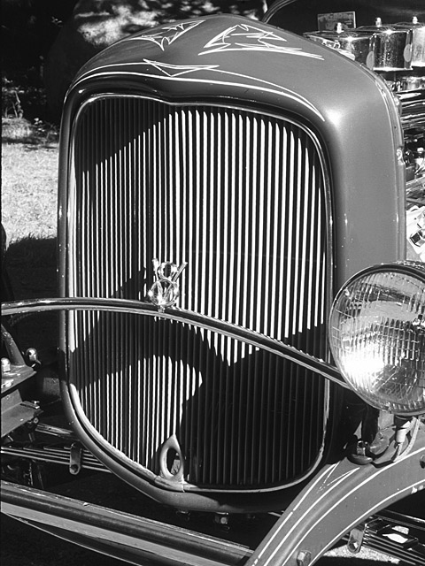 The '32 grille on Fred Steele's roadster was sectioned 6 1/4-inches to accommodate the car's deep channel and retain those great proportions. Its striping looks like Von Dutch but it was actually done many years ago by Ron Lussier of Worcester, MA. The reshaped grille bar retains the stock '32 V-8 badge. Original headlights, seen in old photos of the car, were Guides with parking lights on top; today's are better suited.