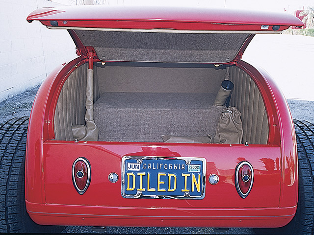 The electric trunk motor still works flawlessly to this day. A custom-made 18-gallon gas tank is hidden within the trunk.