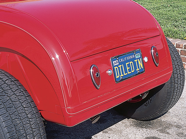In back on the Gibbon Model A roadster body--Magoo was a big fan of '39 Ford taillights and rolled aluminum pans by Jack Hagemann.
