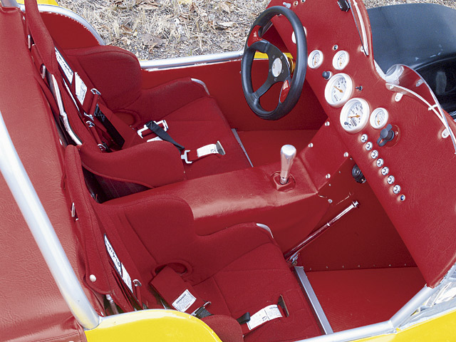 ...The rest of the interior is rather basic, functional, and quite RED! Ultra-Shield drag seats are used with five-point Ultra-Shield harnesses.