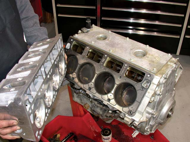 The cylinder heads are attached to the block with four bolts per cylinder and use multilayer steel head gaskets. The cast-aluminum cover that seals the hot oil in the lifter valley from the bottom of the intake adds to block structure and houses two electronic knock sensors.