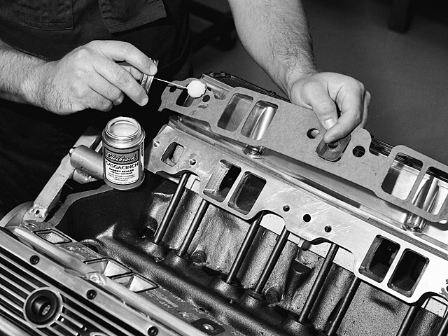 As the installation process begins, use a sealing material on the backside of the gasket and the head surfaces of the engine.