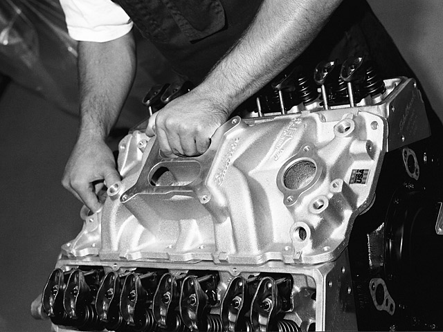 Place the manifold in position in a straight down motion taking care not to disturb the gasket and water inlet seals.