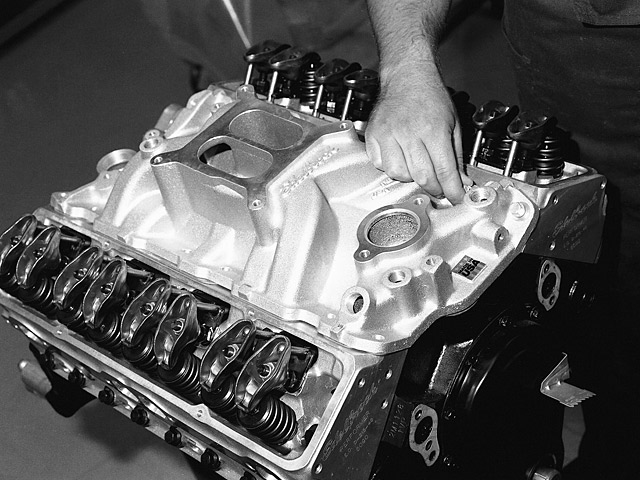 Installing the manifold bolts requires checking the torque specifications recommended by the manufacturer. It should be noted that the small-block Chevy has two distinct styles in bolt patterns. The early models have a six-bolt per side pattern with an angled entry, while the late-model Vortec version has four bolts per side with a straight down entry. Each has different torque specifications and great care should be given to checking the installation instructions for the correct readings.