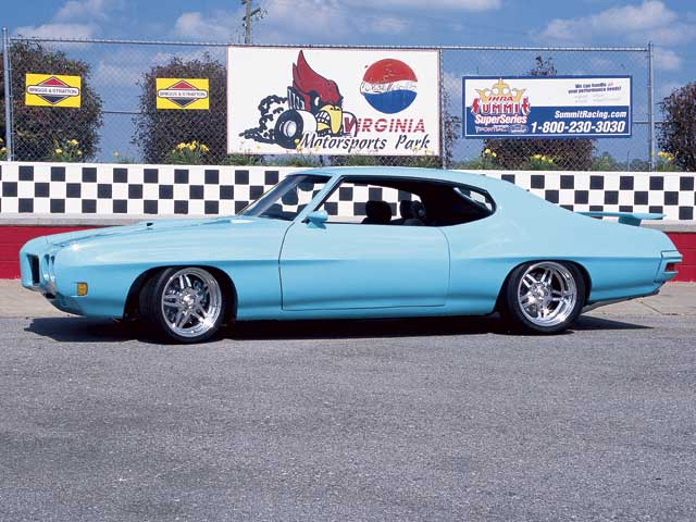 The nose and fenders on Chuck Hamly's GTO are fiberglass from VFN, as isthe lift-off hood. Out back, the rear quarter-skins are made fromfiberglass as well. Chuck bought them in 1983 before he even owned thisparticular '70 GTO--he's had others. The quarter-skins were panel bondedwith SMC adhesive.