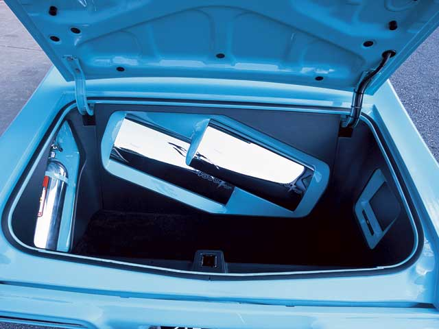 The nitrous bottle, amps, 8-inch LCD, and DVD player are encased inbody-color fiberglass and wood enclosures in the trunk.