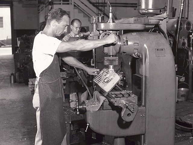 During the peak of the Flathead years, Edelbrock Equipment was known all over the country. The name was established on the West Coast, but it was equally well known in the deep South, with Whiskey Runners and dirt track racers. Veteran Edelbrock employee Bill Likes runs some high compression heads through the machining process.