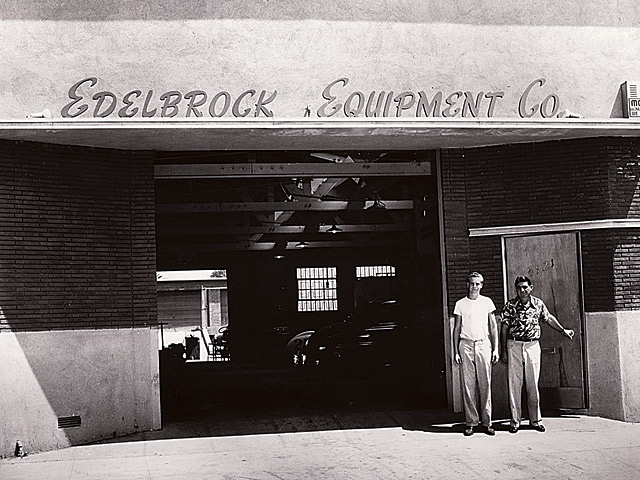 Father and son take time for a photo at the opening of the Edelbrock shop at 4921 West Jefferson Boulevard in 1949.