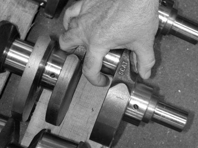 A typical crank failure will occur in the area shown here, where a journal meets the cheek of the crank throw. It is a natural stress concentration point, and also an area where the grain structure is most disrupted in a forging. Generous fillet radii in the corners of the journals are a big help.   CC