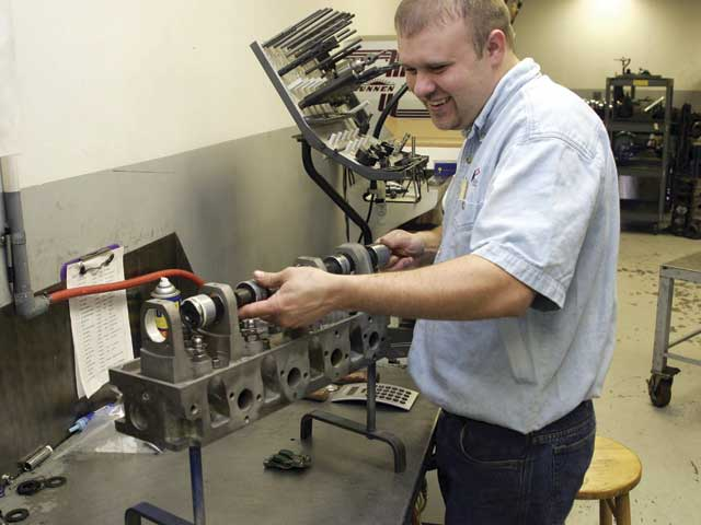 After coating the cam bearings with high-pressure lube, Troutmaninstalls the camshaft in preparation for his first test fit.