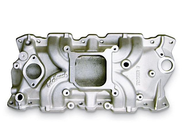 Edelbrock's most reserved single-plane is the Torker II, designed for moderate street or street/strip applications. The manifold is relatively low for hood clearance, with the corresponding runner shape being widely sweeping and long to accommodate the available space and produce a straight approach to the head. The long runners are of a moderate cross-section, while the plenum is large and open. Compare the layout to the racier single planes.