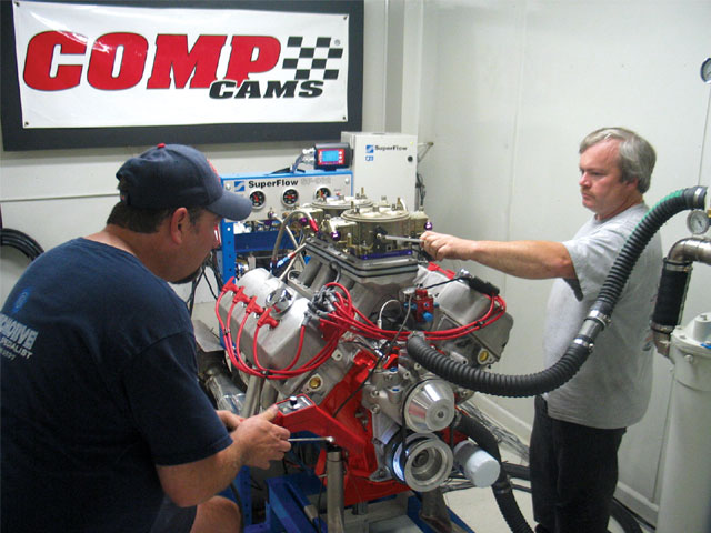 Jeff Dickey (on right) and his team were very efficient, tuning their engine to more power between each pull. Their teamwork was nearly as impressive as the power their engine made.